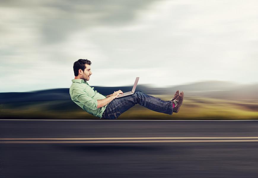 man on laptop using very fast broadband