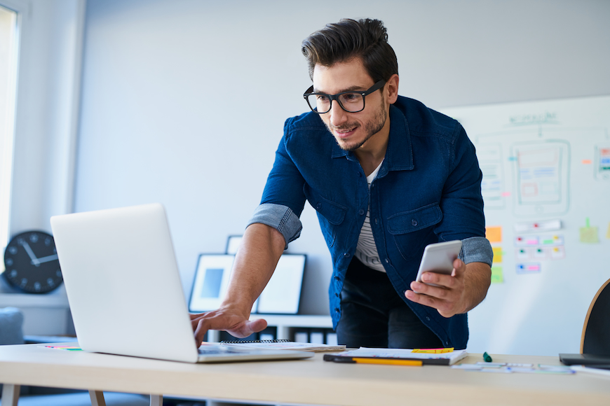 Man looking at laptop to compare internet providers