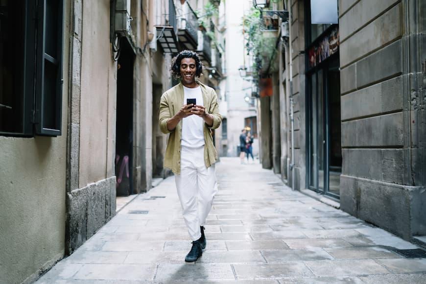 Man walking down the street on phone