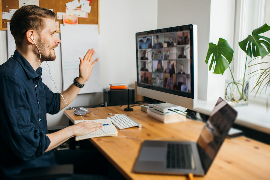 Man working from home at his desk in a video conference