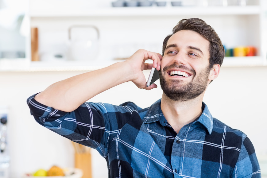Man talking on the phone in his own home.